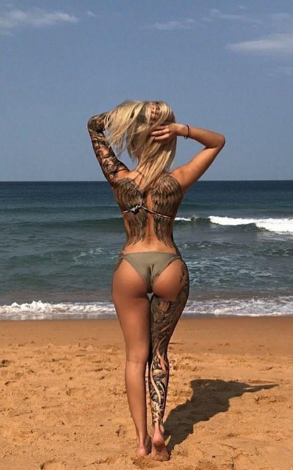 Ну, очень красивые девушки с шикарными татуировками (53 фото) 48